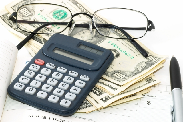 calculator, glasses and money