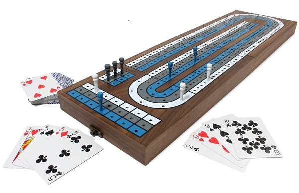 photo of cribbage board and deck of playing cards