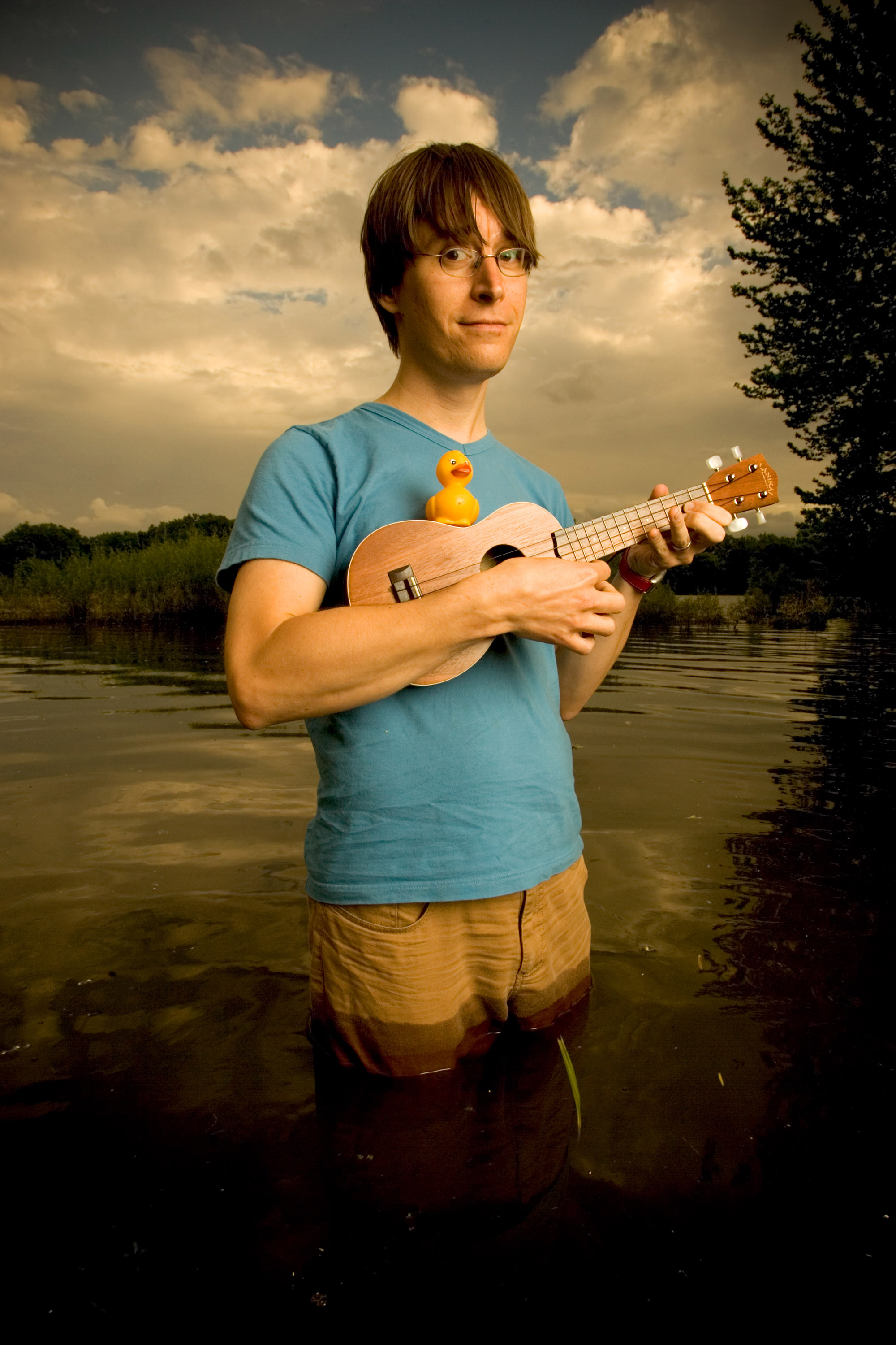 photo of man holding ukulele
