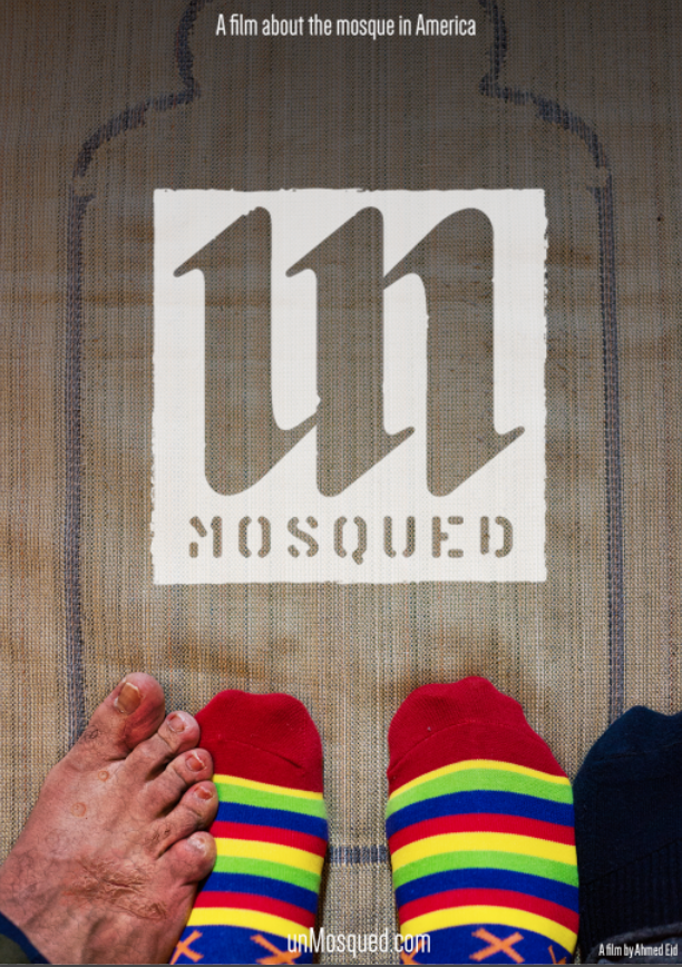 unmosqued log and colorful stocking feet next to bare feet