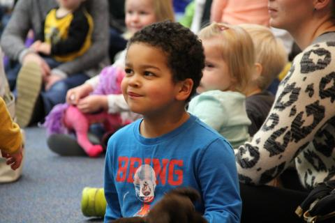 A child enjoying Preschool Storytime