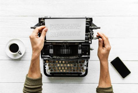man using typewriter