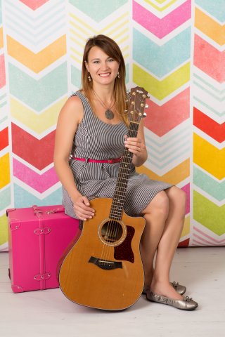 photograph of woman with guitar.