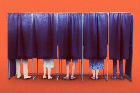 people in voting booth